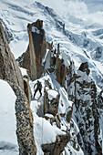Caucasian hiker on snowy mountain, Chamonix, Haute-Savoie, France
