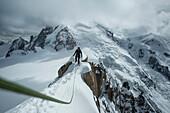 Caucasian hiker walking on snowy mountain, Chamonix, Haute-Savoie, France