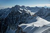 Hikers walking on snowy mountain, Chamonix, Haute-Savoie, France