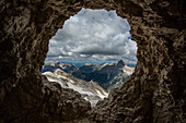 Remote mountain landscape viewed through rock formation