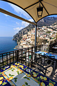 Positano, from a cliffside cafe, Costiera Amalfitana (Amalfi Coast), UNESCO World Heritage Site, Campania, Italy, Europe