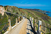 Road connecting the narrow isthmus of Greater and Little Sark, Channel Islands, United Kingdom, Europe