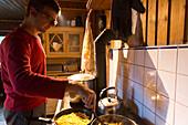Cooking inside the mountain hut, alp, MR, Maria Alm, Berchtesgadener Land, Alps, Austria, Europe