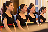 Young Chinese women singing, choir rehearsal, Chinese choir at the Bachfest Leipzig 2015, Bach Academy, Leipzig, Saxony, Germany