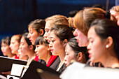 Young Chinese and German women singing at a concert, choir at the open air concert, German Chinese choir at the Bachfest Leipzig 2015, Bach Academy, Leipzig, Saxony, Germany