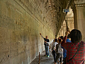Guide with tourists at the Angkor Wat Archaeological Park, UNESCO World Heritage Site, Siem Reap, Cambodia, Indochina, Southeast Asia, Asia