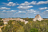 Pyramid of the Magician on right, and Nun's Quadrangle to the left, Uxmal, Mayan archaeological site, UNESCO World Heritage Site, Yucatan, Mexico, North America