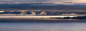 Panoramic view of dawn breaking across the sound of Raasay and the Isle of Rona taken from the Isle of Skye, Inner Hebrides, Scotland, United Kingdom, Europe