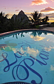 swimming pool of La Haut Plantation hotel at sunset with view to palm trees and volcano mountains The Pitons with Gros and Petit Piton, UNESCO world heritage, Soufriere, St. Lucia, Saint Lucia, Lesser Antilles, West Indies, Windward Islands, Antilles, Car