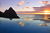 swimming pool of La Haut Plantation hotel at sunset with sea view and volcano mountains The Pitons with Gros and Petit Piton, UNESCO world heritage, Soufriere, St. Lucia, Saint Lucia, Lesser Antilles, West Indies, Windward Islands, Antilles, Caribbean, Ce