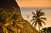 sunset with sea view, sailing ship and volcano mountains The Pitons, Gros Piton, Pitons Bay, UNESCO world heritage, Soufriere, St. Lucia, Saint Lucia, Lesser Antilles, West Indies, Windward Islands, Antilles, Caribbean, Central America