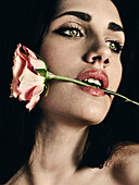 Young Adult Woman Biting Rose Stem