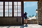 Young Adult Woman Looking at Panoramic View from Village Doorway, Rear View, Lanslevillard, Val Cenis Vanoise, France