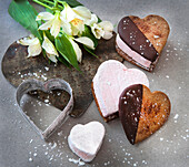 Heart-Shaped Cookies Dipped in Chocolate with Pink Marshmallow Filling