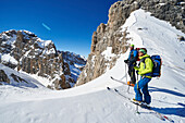 Two men standing on the peak of Cima Groste, ski touring, Brenta Dolomites, Trentino, Italy