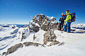 Two men standig on the peak of Cima Groste, ski touring, Brenta Dolomites, Trentino, Italy