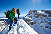 Two men standing on the peak of Cima Falkner in the backdrop Cima Brenta, Skitour, Brenta Gebirge, Dolomites, Trentino, Italien