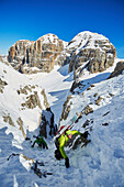 Two Men are skitouring on the way to Cima d´Agola in the Area of the Brenta Dolomites Madonna di Campiglio, Skitour, Brenta Gebirge, Dolomites, Trentino, Italien
