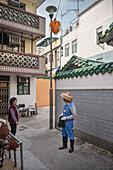 locals having conversation at alleys of Cheng Chau Island, Hongkong, China, Asia