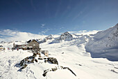 Bella Vista Mountain Hut and mountain range with snow, Schnalstaler Glacier, South Tirol, Italy