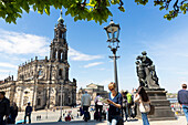 Female tourist with city map, guide book, view from Bruehl's Terrace, Dresden cathedral, Catholic Court Church, Semper Opera House, MR, Dresden, Saxony, Germany, Europe