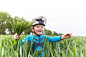 Boy in a cornfield, Family bicycle tour along the river Elbe, adventure, from Torgau to Riesa, Saxony, Germany, Europe