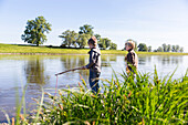 Boys fishing, Family bicycle tour along the river Elbe, adventure, from Torgau to Riesa, Saxony, Germany, Europe