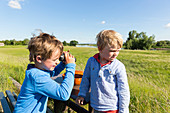 Boys with a binoculars, family bicycle tour along the river Elbe, adventure, from Torgau to Riesa, Saxony, Germany, Europe