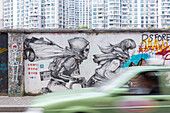 Funny graffiti on wall on Moganshan Road, car passing, street art, Art district at Wusong River, Putuo District, Shanghai, China, Asia
