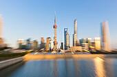 Symbol of Shanghai, skyline, dynamic zoom photo, sunset, Oriental Pearl Tower, Shanghai World Financial Center, Jinmao Tower, Shanghai Tower, Huangpu River, Shanghai, China, Asia