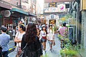 Young women, Tianzifang, arts and crafts area, visitors on street, shops, shopping street, French Concession area, Shanghai, China, Asia