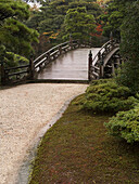 Ancient Japanese stone bridge in Imperial park, Kyoto, Japan