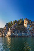 Spruce trees top the cliffs of the Lower Canyon of the Noatak River, Noatak, Alaska, United States of America