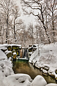 Snow-covered waterfall in The Loch, Central Park, New York City, New York, United States of America