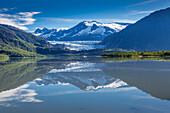 View of the Mendenhall Glacier reflected in Mendenhall Lake near Juneau, Southeast Alaska, Summer