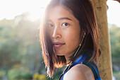 Portrait of a Chinese girl listening to music, Xiamen, Fujian province, China