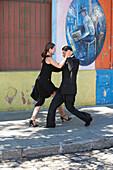 Couple Dancing A Tango On Calle Caminito, Barrio La Boca, Buenos Aires, Capital Federal, Argentina