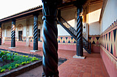 Walls With Frescoes With Tropical Motifs And Carved Wooden Columns Surrounding The Courtyard, Jesuit Mission Of Concepcion, Santa Cruz Department, Bolivia
