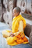 Buddhist Nun Meditating, Mahabodi Temple, Bodhgaya, Bihar, India
