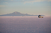4X4 Vehicle In The Salar De Uyuni, The World's Largest Salt Flat At Sunrise, Potosi Department, Bolivia