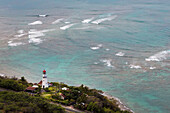 View of Diamond Head Lighthouse with waves breaking in the shallow water in background, Honolulu, Oahu, Hawaii, United States of America