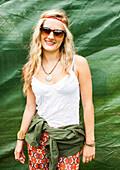 Caucasian woman smiling near tarp