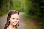 Caucasian girl smiling on dirt road