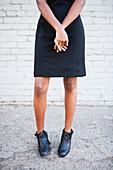Stylish Black woman wearing dress and boots