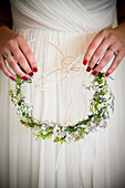 Caucasian bride holding flower headband