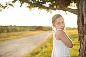 Caucasian girl standing in rural field