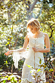 Bride wearing wedding gown in garden