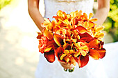 Bride carrying bouquet of flowers