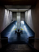 Empty chairs in urban underground tunnel