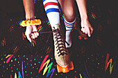 High angle view of woman lacing up roller-skates